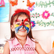 Child with face painting in play room. — Stock Photo #16054295