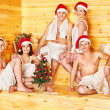 Stock Photo: Group in Santa hat at sauna.