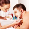 Stock Photo: Clay facial mask in beauty spa.