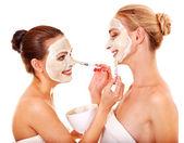 Woman getting facial mask. — Stock Photo