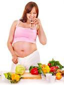 Pregnant woman preparing food . — Stock fotografie