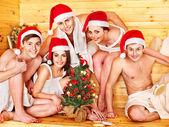Group in Santa hat at sauna. — Stock Photo