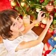 Child with gift box near Christmas tree. — Stock Photo #16506493