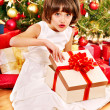 Child with gift box near Christmas tree. — Stock Photo #16506565