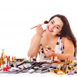 Girl applying makeup. — Stock Photo