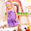 Child painting at easel. — Stock Photo #16508829