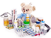 Child medicine and teddy bear. — Stock Photo