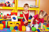 Little girls plaing block and construction set — Stock Photo