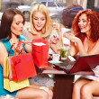 Women at laptop  in a cafe. - Stock Photo