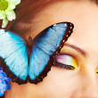 Woman with flower and butterfly. — Stock Photo