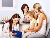 Family on reception at doctor. — Stock Photo