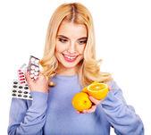 Woman having tablets and lemon. — Stock Photo