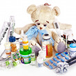 Child medicine and teddy bear. — Stock Photo #19216761