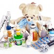 Stock Photo: Child medicine and teddy bear.