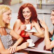 Women at laptop drinking coffee in a cafe. — Stock Photo