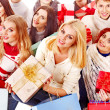 Group holding gift box. — Stock Photo