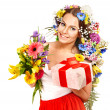 Woman with gift box and flower bouquet . — Stock Photo #19217283