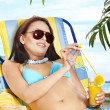 Girl in bikini drinking cocktail. — Stock Photo #19217373