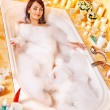 Woman relaxing at bubble bath. — Stock Photo #19217705