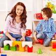 Family with child playing bricks. — Foto Stock