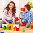 Family with child playing bricks. — Stockfoto