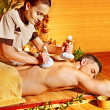 Stock Photo: Mgetting herbal ball massage treatments .
