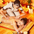 Woman getting bamboo massage. - Stock Photo