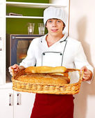 Male chef holding food. — Stock Photo