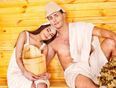 Group in hat at sauna. — Stock Photo