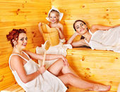 Group with child in sauna. — Stock Photo