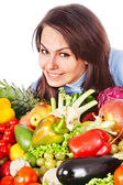 Woman with group of fruit and vegetables. — Stock Photo