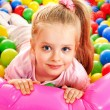 Child in colored ball. — Stock Photo