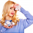 Stock Photo: Young womhaving flu takes pills.