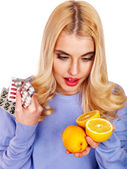 Woman having tablets and lemon. — Stock Photo