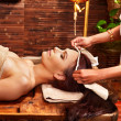 Stock Photo: Woman having ayurveda spa treatment.