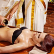 Woman having Ayurvedic spa treatment. — Stock Photo #19997701