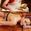 Woman having Ayurvedic spa massage. - Zdjęcie stockowe