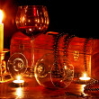 Two wine glass and candle on dark - Stok fotoraf
