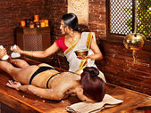 Woman having massage with pouch of rice. — Stok fotoğraf