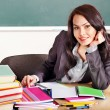 Woman in classroom. - Stock Photo