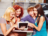 Group with tablet computer at cafe. — Stock Photo