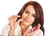 Frau mit pillen und tabletten. — Stockfoto