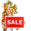 Woman holding sale banner and flower. - Stock Photo