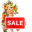 Woman holding sale banner and flower. — Stock Photo #21051133