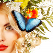 Woman with butterfly and flower. — Стоковое фото