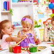 Child painting at easel. — Stock Photo #21052047