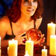 Woman holding scrying ball . - Foto de Stock  