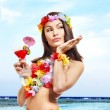 Woman in hawaii costume drink juice. — Stock Photo #21053373