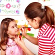 Stock Photo: Child preschooler with face painting.