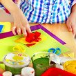 Child making decoration card.. — Stock Photo